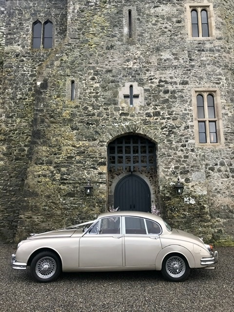 "Our gold Jaguar wedding car, a favourite choice"" width="