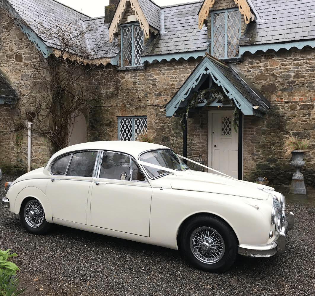 Our beautiful white Jaguar wedding car