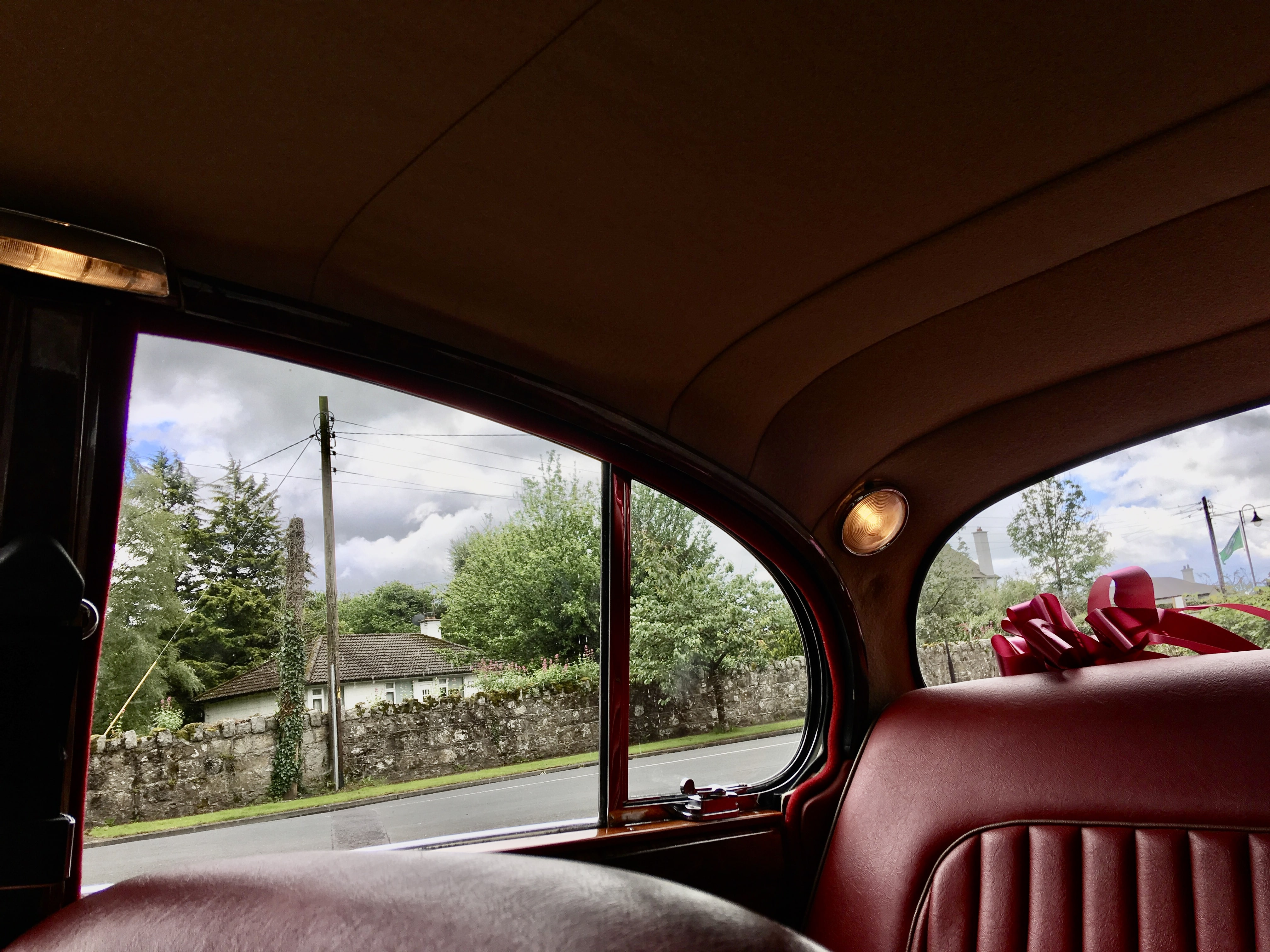 Interior from one of our Classic Jaguar wedding cars