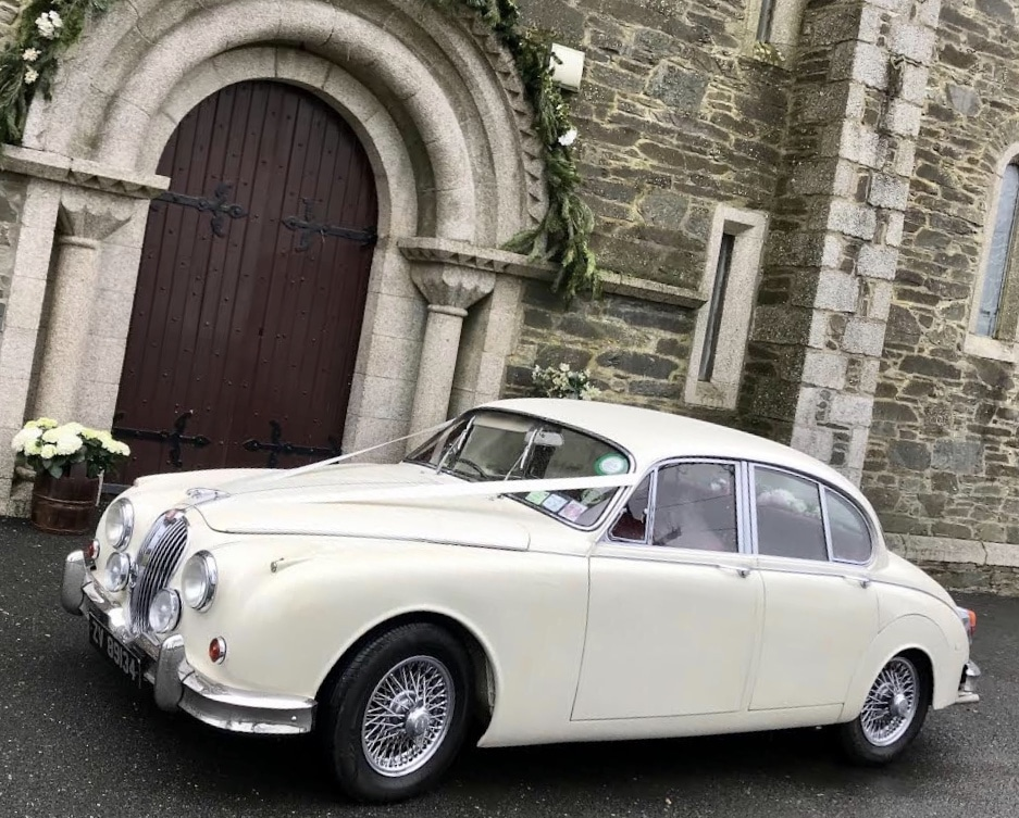 one of our white wedding cars