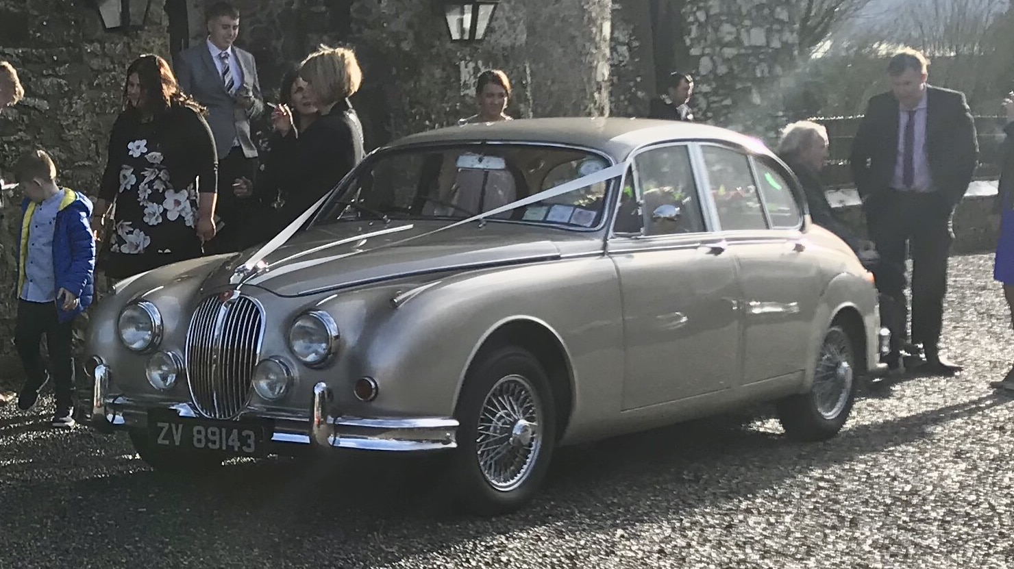 "Our Golden Jaguar wedding car adds a sense of opulence to any wedding day"" width="
