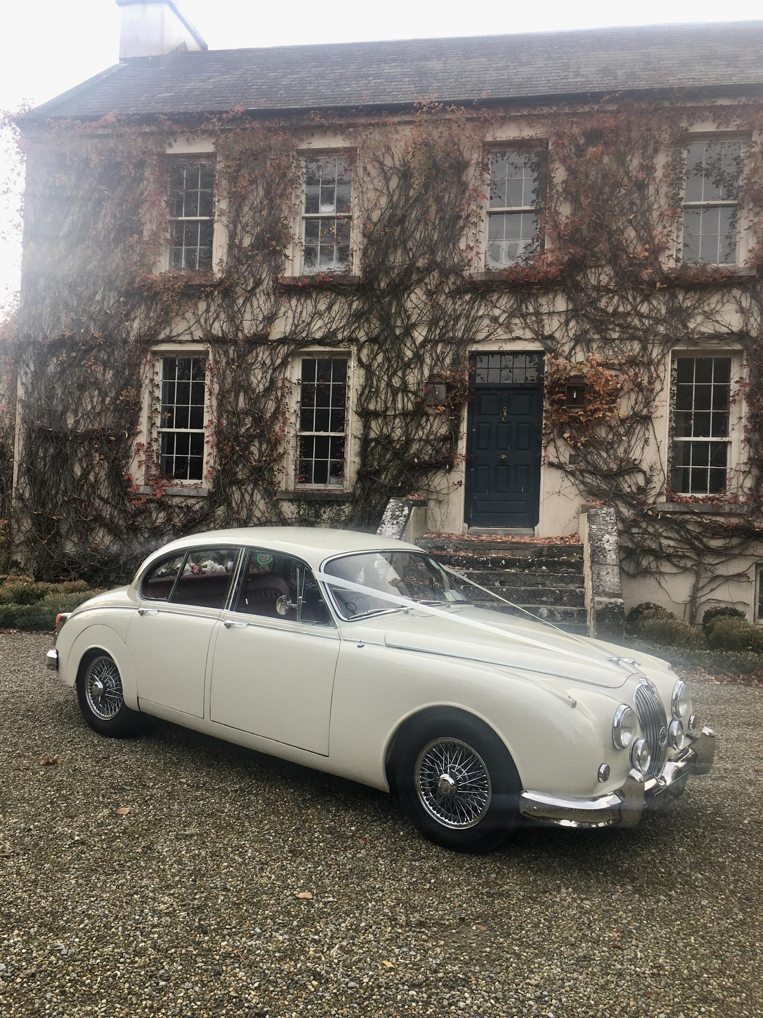 A Classic White wedding car