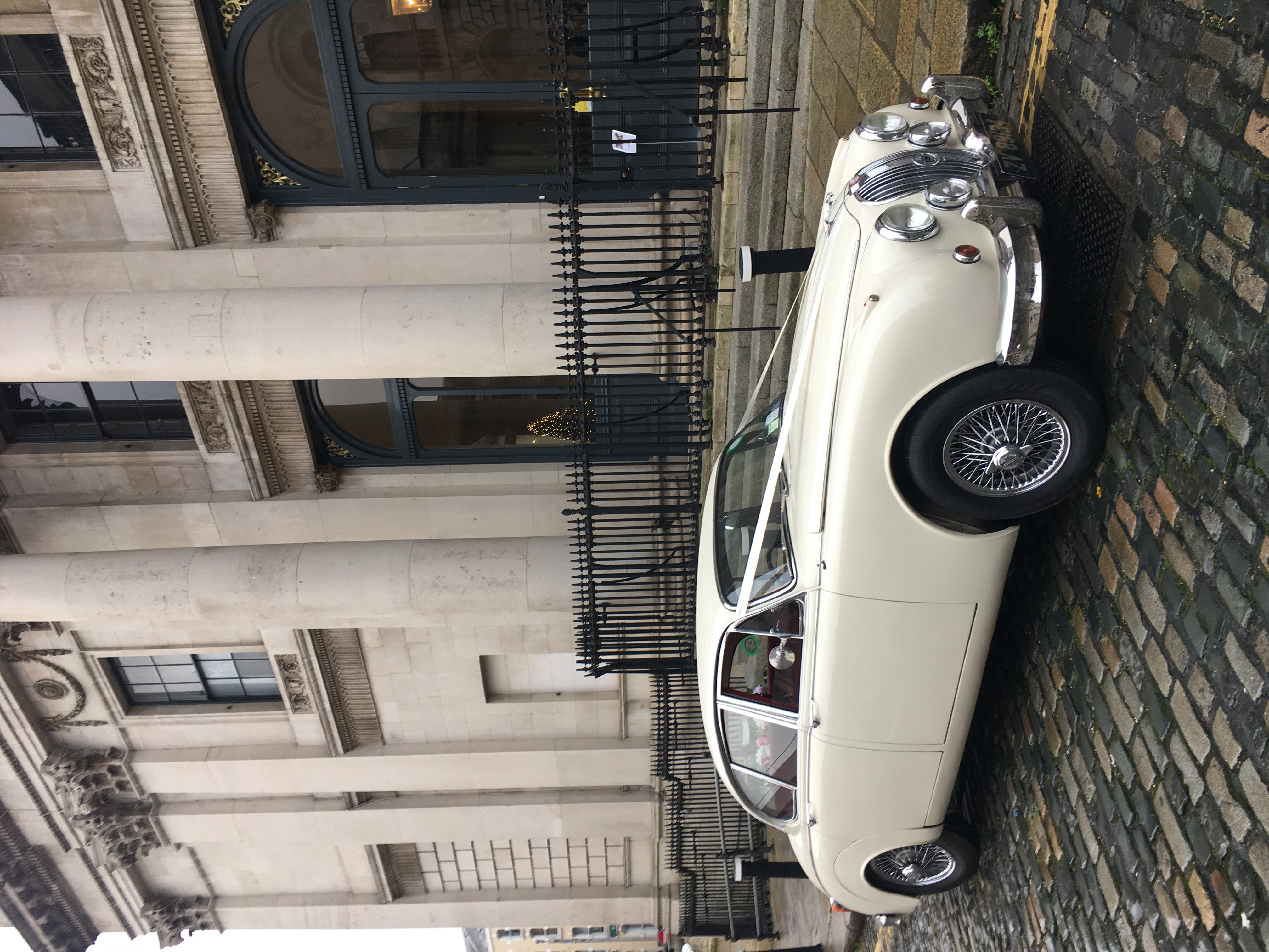 "Mk II Jaguar wedding car in Old English White at City Hall, Dublin""width="